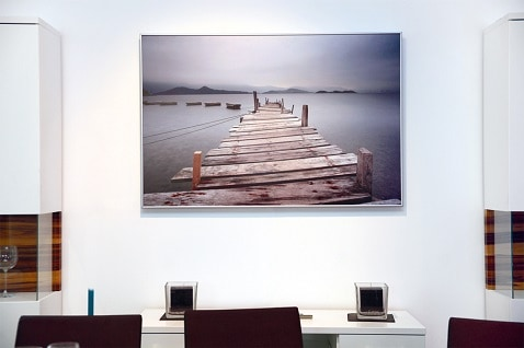 Büroräume durch dekorative Herschel-Bildtafel erwärmt